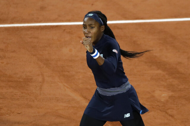 Cori Gauff of the U.S. clenches her fist after scoring a point against Britain's Johanna Konta in the first round match of the French Open tennis tournament at the Roland Garros stadium in Paris, France, Sunday, Sept. 27, 2020. (AP Photo/Alessandra Tarantino)