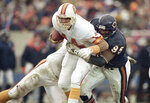 FILE - In this Nov. 6, 1988, file photo, Chicago Bears defensive end Richard Dent (95) sacks Tampa Bay Buccaneers quarterback Vinny Testaverde in the fourth quarter of an NFL football game in Chicago. A U.S. appeals court has revived a lawsuit against the NFL by former players, including Dent, who claim the league illegally plied them with powerful prescription painkillers to keep them on the field. (AP Photo/John Swart, File)