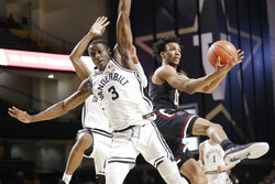 South Carolina's A.J. Lawson, right, drives against Vanderbilt's Maxwell Evans (3) in the first half of an NCAA college basketball game Saturday, March 7, 2020, in Nashville, Tenn. (AP Photo/Mark Humphrey)