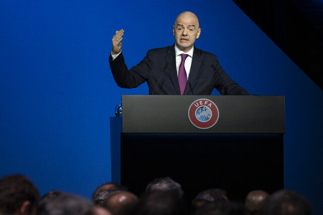 FILE - In this Tuesday, March 3, 2020 file photo, FIFA President Gianni Infantino addresses a meeting of European soccer leaders at the congress of the UEFA governing body in Amsterdam's Beurs van Berlage, Netherlands. Swiss attorney general Michael Lauber has offered to resign in the latest fallout from meetings he had with FIFA president Gianni Infantino during a sprawling investigation into soccer corruption. Lauber offered his resignation to the parliamentary judicial commission ahead of the publication of a federal court ruling in his appeal against being disciplined in March for misconduct. (AP Photo/Peter Dejong, file)