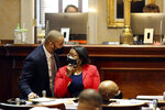 State Reps. John King, D-Rock Hill, left, and Annie McDaniel, D-Winnsboro, confer during a debate about a bill that would require a semester course on America's founding for college students on Thursday, April 15, 2021, in Columbia, S.C. The bill passed 91-12. (AP Photo/Jeffrey Collins)