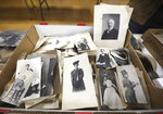 In this Jan. 12, 2021 photo, a box of portraits sit at the auction and antique shop in Geneva, N.Y. David Whitcomb discovered glass negatives, photo equipment, frames and other photo related items from J. E. Hale who took what became Susan B. Anthony's official portrait, in the attic of the building he recently purchased.  The Rochester Democrat and Chronicle reported Tuesday, Aug. 17, 2021,  that Whitcomb, has worked with an antiques dealer to bring some 350 items discovered in the attic to auction. (Tina MacIntyre-Yee/Democrat & Chronicle via AP)