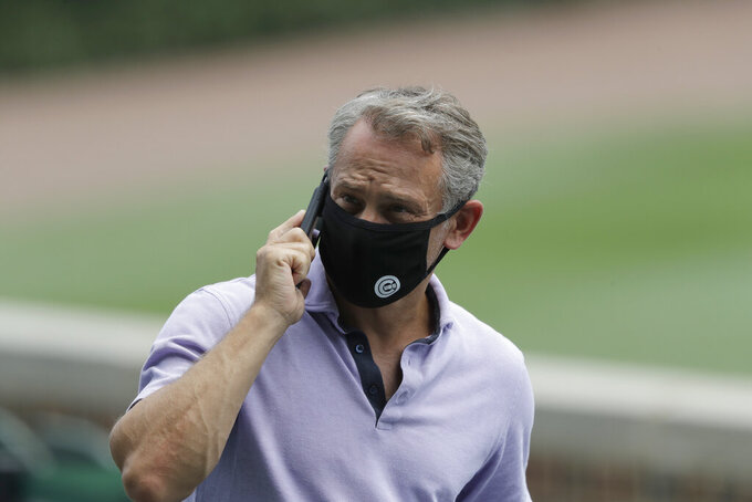 FILE - In this July 8, 2020, file photo, Chicago Cubs general manager Jed Hoyer talks on the phone during team's baseball practice at Wrigley Field in Chicago. Hoyer is disappointed with the team's COVID-19 vaccination rate, and he isn't sure if it will ever reach Major League Baseball's threshold for relaxing some of its coronavirus protocols. Despite the team's vaccination advocacy and education program, the Cubs remain shy of 85% for their Tier 1 players and staff (AP Photo/Nam Y. Huh, File)