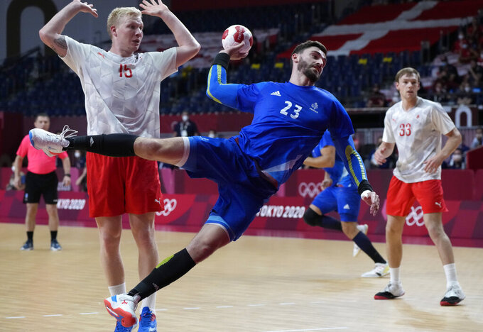 France's Ludovic Fabregas makes a shot during the men's gold medal handball match between France and Denmark at the 2020 Summer Olympics, Saturday, Aug. 7, 2021, in Tokyo, Japan. (AP Photo/Sergei Grits)