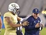 FILE - In this April 26, 2019, file photo, Georgia Tech head coach Geoff Collins, right, reacts as quarterback Lucas Johnson (7) holds him during the team's NCAA college spring football game in Atlanta. Collins is only a few days away from the first big test for his new team, a visit to No. 1 Clemson, the defending national champion Thursday, Aug. 29, 2019. (Hyosub Shin/Atlanta Journal-Constitution via AP, File)