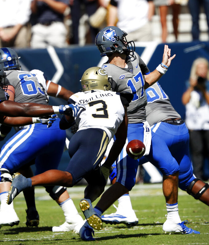 Duke quarterback Daniel Jones (17) has the ball stripped by Georgia Tech defensive back Tre Swilling (3) as he attempts to pass during the first half of the an NCAA college football game, Saturday, Oct. 13, 2018, in Atlanta. (AP Photo/John Bazemore)