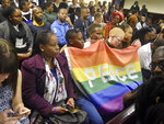 Activists sit in a courtroom to wait the decision by the High Court in Gaborone, Botswana, Tuesday June 11, 2019. Botswana became the latest country to decriminalize gay sex when the High Court rejected as unconstitutional sections of the penal code that punish same-sex relations with up to seven years in prison. (AP Photo)