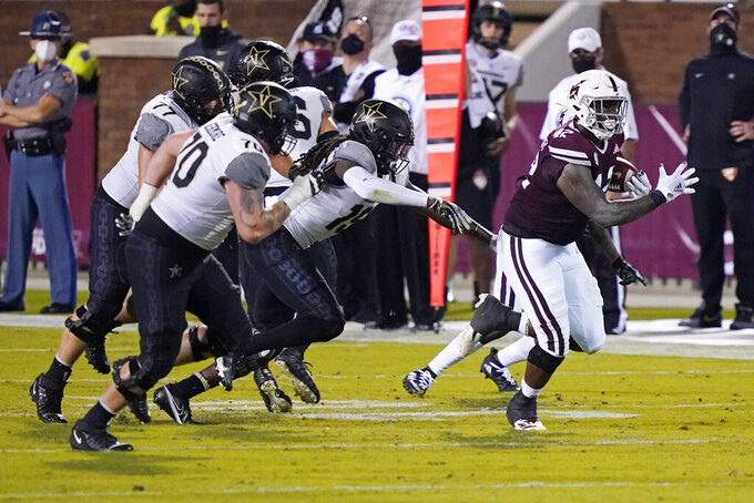 Mississippi State defensive end Marquiss Spencer (42) runs away from Vanderbilt offensive players after intercepting a pass during the second half of an NCAA college football game in Starkville, Miss., Saturday, Nov. 7, 2020. (AP Photo/Rogelio V. Solis)