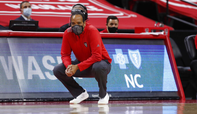 North Carolina State's head coach Kevin Keatts watches during the first half of an NCAA college basketball game against Syracuse Tuesday, Feb. 9, 2021 in Raleigh, N.C. (Ethan Hyman/The News & Observer via AP, Pool)