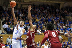 Duke guard Tre Jones (3) shoots while Boston College forward CJ Felder (0) and forward Steffon Mitchell defend during the first half of an NCAA basketball game in Durham, N.C., Tuesday, Dec. 31, 2019. (AP Photo/Gerry Broome)