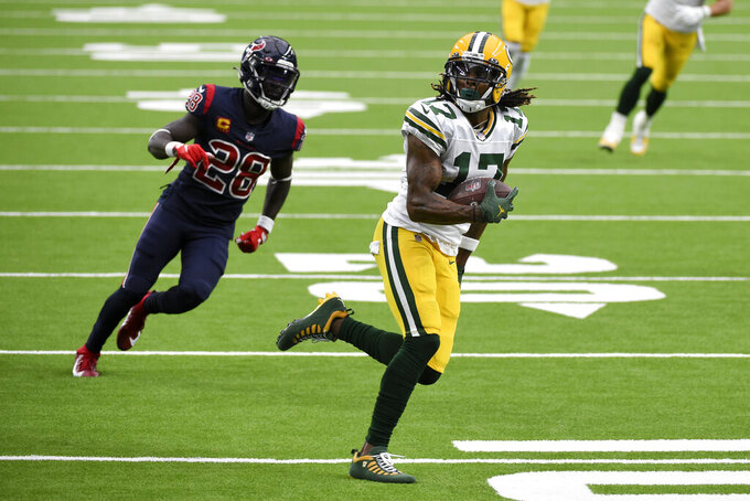 Green Bay Packers wide receiver Davante Adams (17) runs for the end zone past Houston Texans safety Michael Thomas (28) after catching a pass for a touchdown during the second half of an NFL football game Sunday, Oct. 25, 2020, in Houston. (AP Photo/Eric Christian Smith)