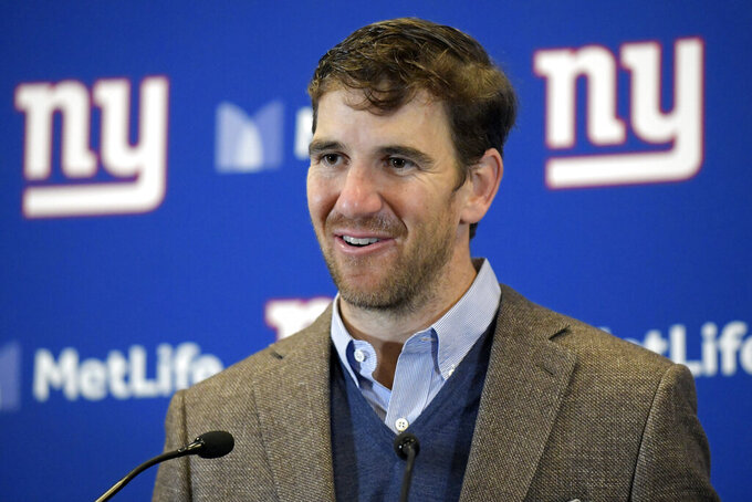 FILE - In this Dec. 2, 2018, file photo, New York Giants quarterback Eli Manning talks to reporters after an NFL football game against the Chicago Bears, in East Rutherford, N.J. Eli Manning has won the Pro Football Writers of America's Good Guy Award for his cooperation with the media. Manning, who retired after the 2019 season, has been lauded for years for his dealings with local and national media. (AP Photo/Bill Kostroun, FIle)