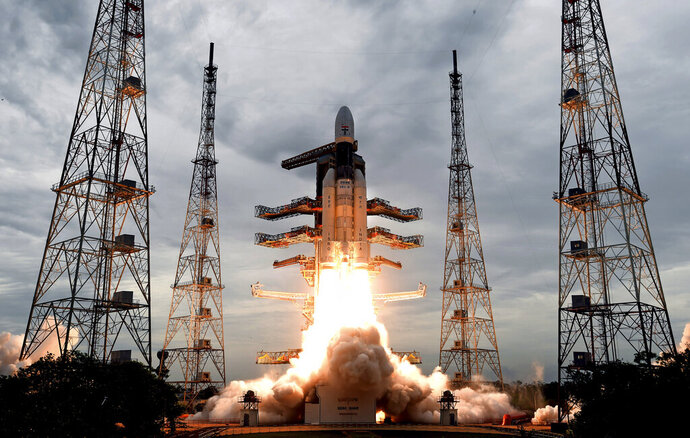 This photo released by the Indian Space Research Organization (ISRO) shows its Geosynchronous Satellite launch Vehicle (GSLV) MkIII carrying Chandrayaan-2 lift off from Satish Dhawan Space center in Sriharikota, India, Monday, July 22, 2019. India successfully launched an unmanned spacecraft to the far side of the moon on Monday, a week after aborting the mission due to a technical problem. (Indian Space Research Organization via AP)
