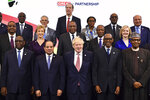 Britain's Prime Minister Boris Johnson, front center, hosts the UK Africa Investment Summit in London, Monday Jan. 20, 2020. Boris Johnson is hosting 54 African heads of state or government in London. The move comes as the U.K. prepares for post-Brexit dealings with the world. Front row from left, Senegal's President Macky Sall, Egypt's President Abdel Fattah al-Sisi, Britain's Prime Minister Boris Johnson, Rwanda's President Paul Kagame, Nigeria's President Muhammadu Buhari. Center row from left, Malawi's President Peter Mutharika, Britain's Business Secretary Andrea Leadsom, Kenya's President Uhuru Kenyatta, Guinea's President Alpha Conde, Britain's International Trade Secretary Liz Truss. Top row from left, Angola's President Joao Lourenco, Algeria's President Abdelmadjid Tebboune, World Bank President David Malpass, UN executive secretary of Economic Commission for Africa Vera Songwe and IMF Africa Director Abebe Aemro Selassie. (Ben Stansall/Pool via AP)