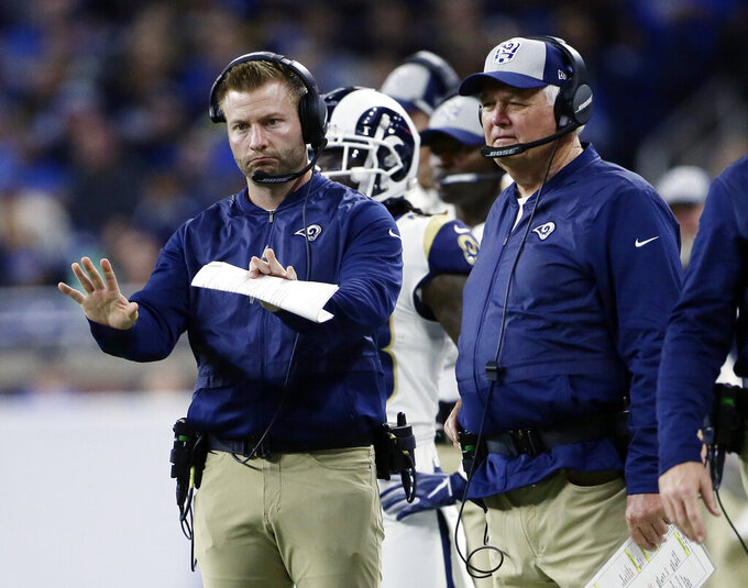 FILE - In this Dec. 2, 2018, file photo, Los Angeles Rams head coach Sean McVay motions to his team beside defensive coordinator Wade Phillips, right, during the second half of an NFL football game, in Detroit. Veteran defensive coordinator Wade Phillips has been fired by the Los Angeles Rams after three winning seasons. Phillips announced Monday, Jan. 6, 2020, on Twitter that the Rams are not renewing his contract. (AP Photo/Duane Burleson, File)