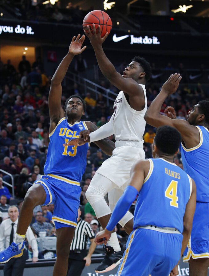 Arizona State's Luguentz Dort shoots over UCLA's Kris Wilkes (13) during the second half of an NCAA college basketball game in the quarterfinals of the Pac-12 men's tournament Thursday, March 14, 2019, in Las Vegas. (AP Photo/John Locher)