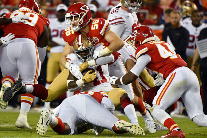 Kansas City Chiefs linebacker Ben Niemann (56) tackles San Francisco 49ers running back Jeff Wilson (41) during the second half of an NFL preseason football game in Kansas City, Mo., Saturday, Aug. 24, 2019. (AP Photo/Ed Zurga)