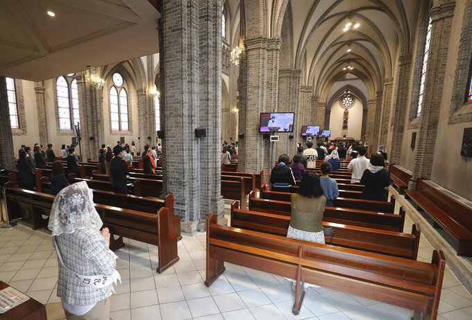 Catholics attends a mass while maintaining social distancing to help curb the spread of the coronavirus at the Myeongdong Cathedral in Seoul, South Korea, Sunday, May 17, 2020. (Lee Jung-hoon/Yonhap via AP)
