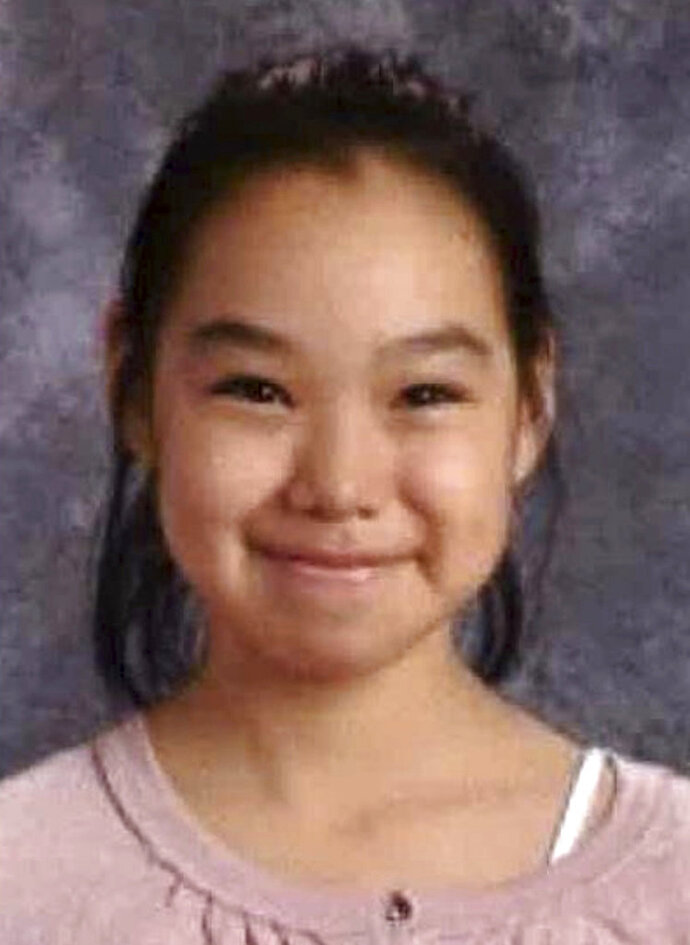 FILE - This undated file photo that is part of a missing person poster released by Alaska State Troopers shows Ashley Johnson-Barr. Authorities in Alaska say a 10-year-old girl has been found dead Friday, Sept. 14, 2018 more than a week after she was reported missing in a remote Inupiat Eskimo town on Alaska's northwestern coast.  Alaska State Troopers said Friday that Ashley Johnson-Barr's remains were found east of Kotzebue. (Alaska State Troopers via AP, File)