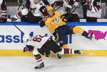 Nashville Predators' Kyle Turris (8) is checked by Arizona Coyotes' Jordan Oesterle (82) during the first period NHL qualifying round game action in Edmonton, on Sunday, Aug. 2, 2020. (Jason Franson/The Canadian Press via AP)