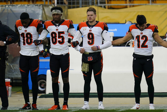Members of the Cincinnati Bengals stand during the national anthem before an NFL football game against the Pittsburgh Steelers, Sunday, Nov. 15, 2020, in Pittsburgh. (AP Photo/Keith Srakocic)