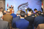 In this Monday, Dec. 2, 2019 photo, released by the Syrian official news agency SANA, Syria's Deputy Foreign Minister Faisal Mekdad gives a speech during a ceremony to mark United Arab Emirates' National Day, in Damascus, Syria. During the ceremony UAE Charge d'affaires Abdul-Hakim Naimi praised Syrian President Bashar Assad's