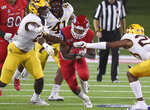 Fresno State's Ronnie Riveres, center, tries to run up the middle against Minnesota during an NCAA college football game Saturday, Sept. 7, 2019, in Fresno, Calif. (Eric Paul Zamora/The Fresno Bee via AP)