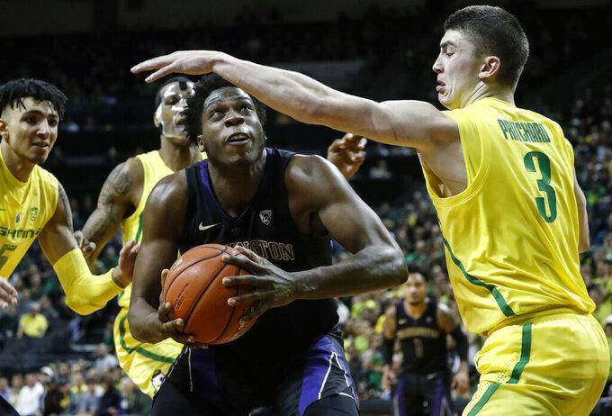 Washington forward Noah Dickerson, looks for a shot as Oregon guard Payton Pritchard (3) defends during an NCAA college basketball game Thursday, Jan. 24, 2019, in Eugene, Ore. (AP Photo/Thomas Boyd)