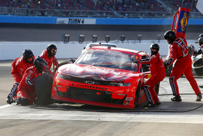 Justin Allgaier (7) makes a pit stop for tires and fuel during the NASCAR Xfinity Series auto race at Phoenix Raceway, Saturday, Nov. 7, 2020, in Avondale, Ariz. (AP Photo/Ralph Freso)