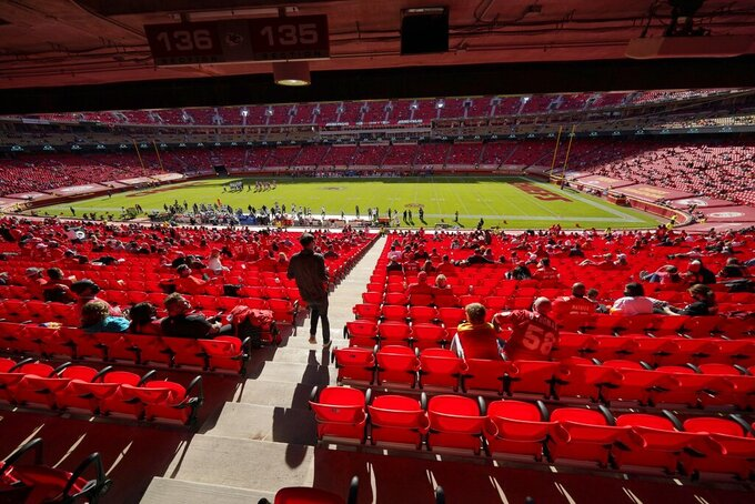 A limited audience at Arrowhead Stadium watch as the New York Jets play the Kansas City Chiefs in the second half of an NFL football game on Sunday, Nov. 1, 2020, in Kansas City, Mo. (AP Photo/Charlie Riedel)