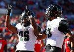 Hawaii running back Miles Reed (26) celebrates with quarterback Cole McDonald (13) after scoring a touchdown against New Mexico during the first half of an NCAA college football game on Saturday, Oct. 26, 2019, in Albuquerque, N.M. (AP Photo/Andres Leighton)