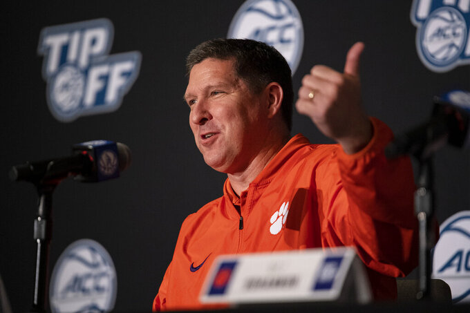 Clemson head coach Brad Brownell answers a question during NCAA college basketball Atlantic Coast Conference media day, Tuesday, Oct. 12, 2021, in Charlotte, N.C. (AP Photo/Matt Kelley)