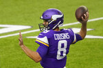 Minnesota Vikings quarterback Kirk Cousins warms up before an NFL football game against the Atlanta Falcons, Sunday, Oct. 18, 2020, in Minneapolis. (AP Photo/Jim Mone)