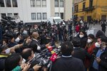 Reporters interview a lawmaker outside Congress in Lima, Peru, Friday, Sept. 18, 2020. Peruvian President Martin Vizcarra's job is on the line Friday as opposition lawmakers push through an impeachment hearing criticized as a hasty and poorly timed ouster attempt in one of the countries hardest hit by the coronavirus pandemic. (AP Photo/Rodrigo Abd)
