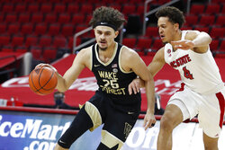 FILE - Wake Forest's Ismael Massoud (25) drives by North Carolina State's Jericole Hellems (4) during the first half of an NCAA college basketball game in Raleigh, N.C., in this Wednesday, Jan. 27, 2021, file photo. Among the newcomers at Kansas State are Arkansas-Little Rock transfer Markquis Nowell, Missouri guard Mark Smith and Wake Forest forward Ismael Massoud.(Ethan Hyman/The News & Observer via AP, Pool, File)