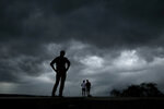 People watch from the Liberty Memorial as a severe storm that dropped several tornados earlier approaches downtown Kansas City, Mo., Tuesday, May 28, 2019. (AP Photo/Charlie Riedel)