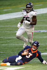 Denver Broncos quarterback Drew Lock (3) slides after a run against the Atlanta Falcons during the second half of an NFL football game, Sunday, Nov. 8, 2020, in Atlanta. (AP Photo/Brynn Anderson)