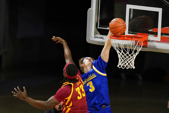 South Dakota State guard Baylor Scheierman (3) dunks the ball over Iowa State forward Solomon Young (33) during the first half of an NCAA college basketball game, Wednesday, Dec. 2, 2020, in Ames, Iowa. (AP Photo/Charlie Neibergall)