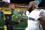 Pittsburgh Steelers free safety Minkah Fitzpatrick, left, and Miami Dolphins cornerback Xavien Howard visit on the field following an NFL football game in Pittsburgh, Monday, Oct. 28, 2019. The Steelers won 27-14. (AP Photo/Don Wright)