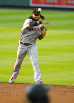 San Francisco Giants shortstop Brandon Crawford throws to first for the out against Colorado Rockies' Raimel Tapia during the second inning of a baseball game, Wednesday, Aug. 5, 2020, in Denver. (AP Photo/Jack Dempsey)