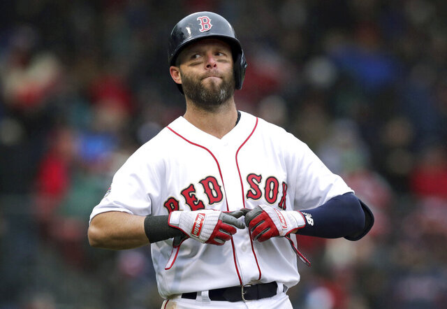 FILE - In this Tuesday, April 9, 2019 file photo, Boston Red Sox's Dustin Pedroia takes off his gloves after lining out to right field to end the sixth inning of the home opener baseball game against the Toronto Blue Jays in Boston. Red Sox second baseman Dustin Pedroia had what the team called a