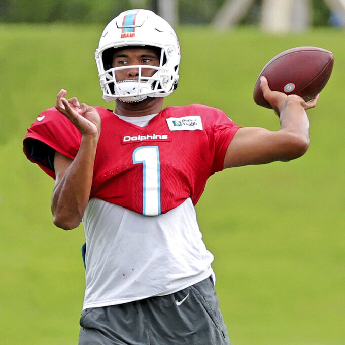 Miami Dolphins quarterback Tua Tagovailoa (1) sets up to pass during NFL football practice in Miami Gardens Fla., Wednesday, Oct. 13, 2021. The Dolphins play against the Jacksonville Jaguars in London on Sunday. (David Santiago(David Santiago/Miami Herald via AP)