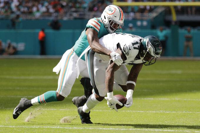 Miami Dolphins defensive back Ken Webster (31) tackles Philadelphia Eagles wide receiver Alshon Jeffery (17), during the first half at an NFL football game, Sunday, Dec. 1, 2019, in Miami Gardens, Fla. (AP Photo/Lynne Sladky)