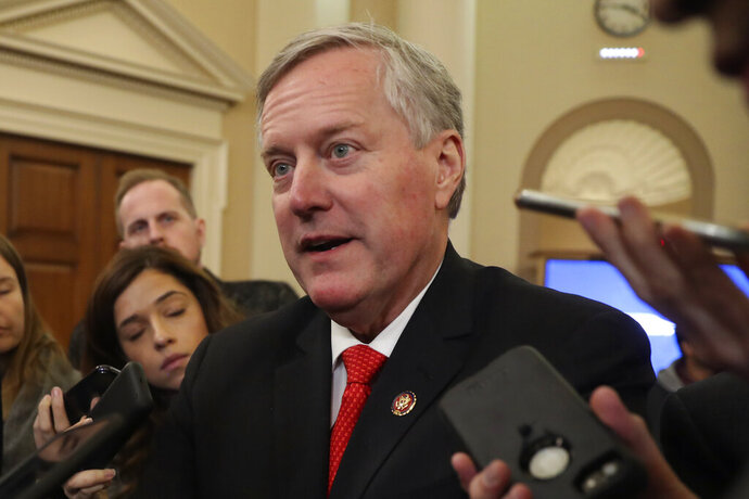 FILE - In this Nov. 13, 2019, file photo, Rep. Mark Meadows, R- N.C., speaks to reporters as the hearing with top U.S. diplomat in Ukraine William Taylor, and career Foreign Service officer George Kent, at the House Intelligence Committee ends on Capitol Hill in Washington.  In a statement Thursday, Dec. 19, 2019, the North Carolina congressman and top ally to President Donald Trump says he struggled with the decision and came to it after discussion with his family.(AP Photo/Andrew Harnik, File)