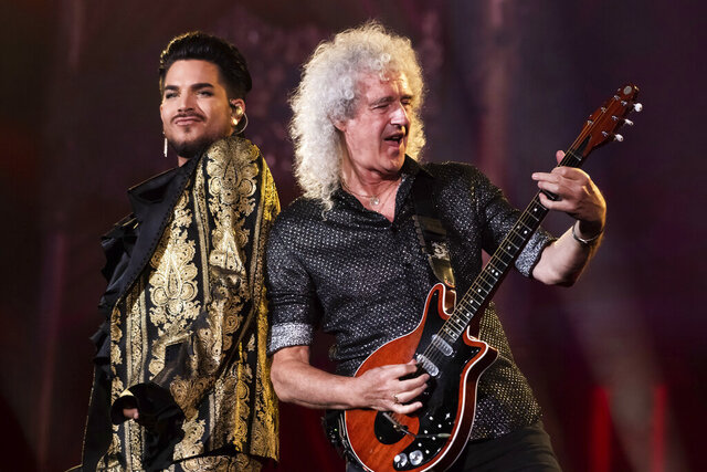 """FILE - In this Sept. 28, 2019 file photo, Adam Lambert, left, and Brian May, of Queen, perform at the Global Citizen Festival in New York. Lambert and May, along with bandmate Roger Taylor, recently gathered virtually to record a new version of the Queen classic, """"We Are the Champions."""" """"You Are the Champions"""" was released early Friday on all streaming and download services, with proceeds going to the World Health Organization's COVID-19 Solidarity Response Fund.  (Photo by Charles Sykes/Invision/AP, File)"""