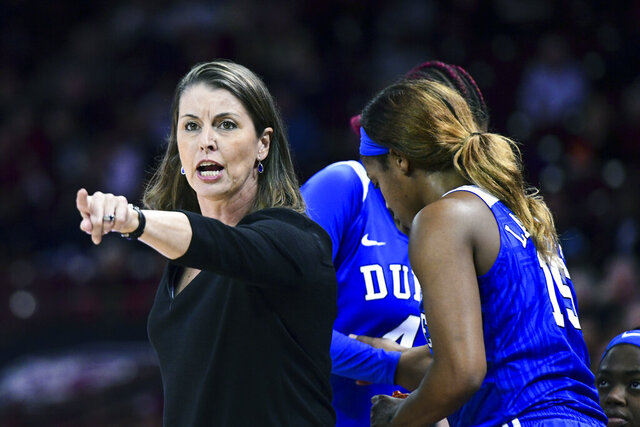 "FILE - In this Dec. 19, 2019, file photo, Duke coach Joanne P. McCallie communicates with players during the second half of the team's NCAA college basketball game against South Carolina, in Columbia, S.C. McCallie won't return for a 14th season as Duke's women's basketball coach. McCallie announced her departure in a 6-minute video posted Thursday, July 2, 2020, on the program's Twitter account. She said she was ""choosing to step away"" as coach, saying she wanted to bring ""clarity"" instead of uncertainty as she entered the final year of her contract. (AP Photo/Sean Rayford, File)"