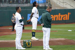 Oakland Athletics' Sean Manaea, center, and teammates stand during a moment of silence for victims in Kabul before a baseball game between the Athletics and the New York Yankees in Oakland, Calif., Friday, Aug. 27, 2021. (AP Photo/Jeff Chiu)