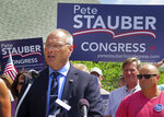FILE - In this Monday, July 10, 2017, file photo, St. Louis County Commissioner and Duluth Police Lt. Pete Stauber announces that he will seek the Republican endorsement in the race to represent Minnesota's 8th Congressional District in 2018 at an event in Hermantown, Minn. President Donald Trump is heading to Minnesota to stump for Stauber, but another test of GOP loyalty to the president looms large over his visit. (Dan Kraker/Minnesota Public Radio via AP, File)