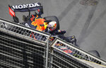 Red Bull driver Max Verstappen of the Netherlands looks over the barrier from his car after hitting a wall during the third free practice session at the Baku Formula One city circuit in Baku, Azerbaijan, Saturday, June 5, 2021. The Azerbaijan Formula One Grand Prix will take place on Sunday. (AP Photo/Darko Vojinovic)