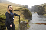 In this photo taken Wednesday, May 1, 2019, Hanna Johannsdottir, a ranger from The Environment Agency of Iceland, poses for a photograph at the mouth of the Fjadrargljufur canyon. The canyon area has suffered environmental damages after intense traffic, prompted by the music video